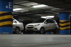 Suv on underground parking. Side of red car on the underground parking Royalty Free Stock Photos