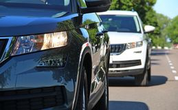 SUV vehicle pursues the same SUV vehicle on the road Royalty Free Stock Images
