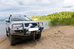 SUV in the water on the background of the lake Royalty Free Stock Photos