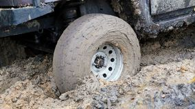 SUV 4WD car stuck in muddy off-road. stock video footage