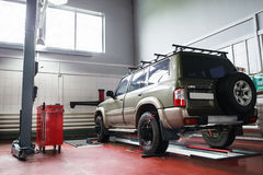 SUV wheel alignment at professional service Stock Image