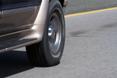 SUV Wheel Motion. The front wheel of a truck moving on the highway Royalty Free Stock Photos