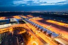 Suvarnabhumi airport at night. Bangkok, Thailand - October 11, 2010: Airplanes and cars park at Suvarnabhumi airport at night Stock Image