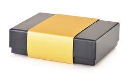 Suvenir box with golden decorative ribbon Stock Images