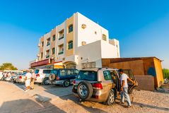 SUVs parked by a house in desert royalty free stock images