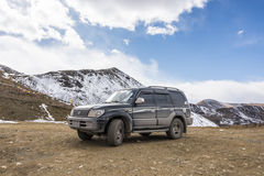 Suvs on sown mountain Stock Photography