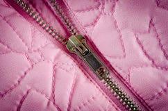 Suwaczek na różowej balon kurtce w górę strzału zdjęcia stock