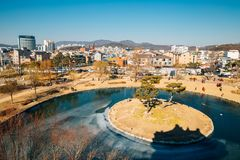 Suwon cityspace and frozen pond at winter in Korea. Suwon, Korea - February 10, 2016 : Suwon cityspace and frozen pond at winter royalty free stock image