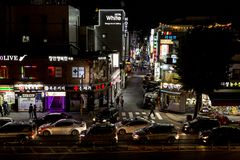 Suwon, South Korea - June 2, 2017: Korean nightlife. People walking down a street near Suwon Hwaseong Fortress Seojangdae stock images