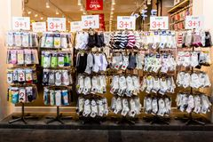 Suwon, South Korea - June 14, 2017: Showcase with socks in the main street in Suwon at night royalty free stock images