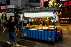 Suwon, South Korea - June 14, 2017: Vendor woman waiting of buyers in her fast food kiosk at main street in Suwon. Street food is royalty free stock images