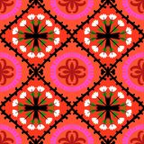 Suzani pattern with Uzbek and Kazakh motifs. Suzani, vector seamless ethnic pattern with Uzbek, Turkish and Kazakh motifs. in bright vibrant colors. Texture for Royalty Free Stock Photo