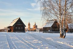 Winter Scene with Russian Old Wooden Houses in Suzdal. SUZDAL, RUSSIA - On the grounds of the Suzdal's open-air museum of Wooden Architecture and Peasant's Royalty Free Stock Images