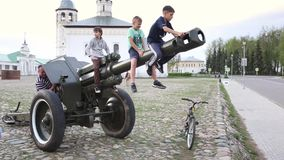 SUZDAL, RUSSIA - May 08, 2019: little boys climb on barrel of artillery gun