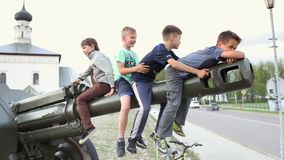 SUZDAL, RUSSIA - May 08, 2019: little boys on barrel of artillery gun laughing
