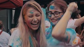 Suzhou, China - March 30, 2019: Young people celebrating holi festival colors. 4K slow motion shot of young people celebrating holi festival colors stock video footage