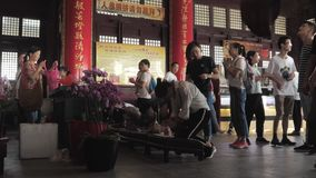 Suzhou, China - October 10, 2018: Chinese people pray in Buddhist temple stock video footage