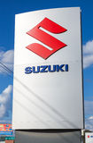 Suzuki dealership sign against blue sky Stock Photography