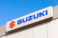 Suzuki dealership sign against blue sky Stock Photos