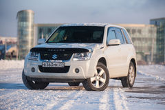 Suzuki Escudo stands in a snowy field Stock Photography