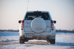 Suzuki Escudo stands in a snowy field Royalty Free Stock Image