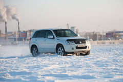 Suzuki Escudo stands in a snowy field Royalty Free Stock Photography