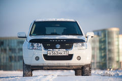 Suzuki Escudo stands in a snowy field Royalty Free Stock Photo