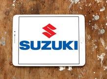 Suzuki logo. Logo of suzuki car brand on samsung tablet on wooden background stock photo