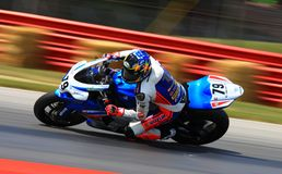 Suzuki Pro bike racing. Motorcycle rider Blake Young is racing his Suzuki GSX-R1000  race bike at the pro motorcycle race event for the Yoshimura Racing team Royalty Free Stock Photography