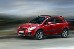 Suzuki red car. Suzuki red car on a blurred background in motion stock image