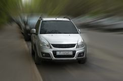 Suzuki silver car. Suzuki silver car on blurred in motion background royalty free stock image