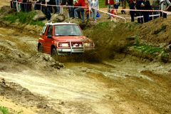 Suzuki vitara  on mud road. Annual  off road competition just started Royalty Free Stock Photos