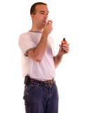 svälja för manmedicin Arkivfoto