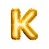 Svälla alfabetet för guld- folie för bokstav K 3D det realistiska Arkivfoton