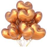 Sväller guld- hjärta formad garnering för partiet för den lyckliga födelsedagen Royaltyfri Bild
