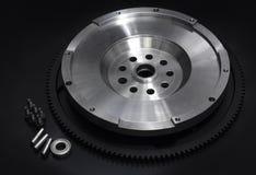 Svänghjul med startknappcirkelkugghjulet Arkivbild