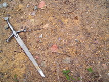 svärd för bakgrundssmutsgrus Royaltyfri Foto