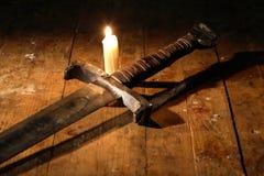 Svärd och stearinljus Arkivfoton