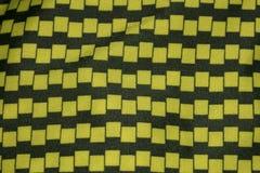 Svärta och gulna tyg, closeup på modell arkivfoton