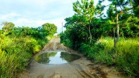 Svår väg i Mocambique Royaltyfri Bild