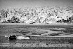 Svalbard Spitzbergen island glacier view. Zodiac near Svalbard Spitzbergen island glacier view landscape panorama in black and white Royalty Free Stock Image