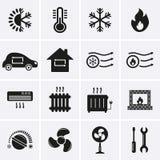 svalnande uppvärmningssymboler Arkivfoto