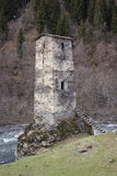 Svan Ancient tower on the bank of the river, Svaneti, Georgia Stock Image