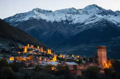 Svan towers with illumination in Mestia at sunrise, Svaneti, Georgia. Royalty Free Stock Image