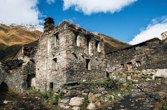 Svan Towers and machub house with flagstone, Ushguli, Svaneti, Georgia stock photography