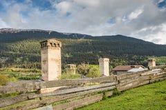 Svan towers in Mestia at sunrise, Svaneti, Georgia. Royalty Free Stock Images