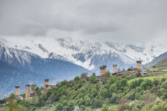 Svan towers in Mestia at sunrise, Svaneti, Georgia. View of the Svanetian towers in Mestia village against snowy mountains. Upper Svaneti, Georgia Stock Photography