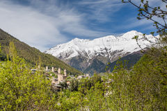 Svan towers in Mestia, Svaneti, Georgia. View of the Svanetian towers in Mestia village against snowy mountains. Upper Svaneti, Georgia Royalty Free Stock Photo