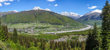 Svaneti mountains, Ushba mountain, panoramic view of the city of Stock Images