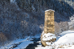 Svaneti tower by the river in winter time Royalty Free Stock Image